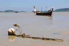 Traditional thai boat during ebb Royalty Free Stock Image