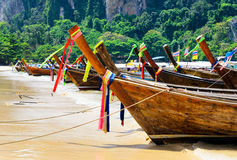 Traditional thai boats at the beach of Krabi provi Stock Photos