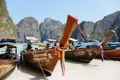 Traditional Thai boats on the beach of Maya Bay on Phi Phi Leh Stock Photos