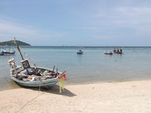 Traditional thai boats on the beach in Thailand Royalty Free Stock Photography