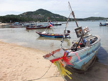 Traditional thai boats on the beach in Thailand Royalty Free Stock Photos