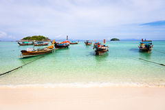 Traditional thai boats on the beach. Wooden long-tail thai boats on the beach of Koh Lipe Island, Thailand royalty free stock images