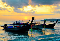 Traditional thai boats at sunset beach.  Stock Images