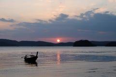 Traditional thai boats at sunset beach. Ao Nang, Krabi province. Royalty Free Stock Photo