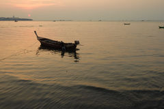 Traditional thai boats at sunset beach. Royalty Free Stock Photo