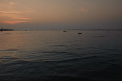 Traditional thai boats at sunset beach. Royalty Free Stock Photos