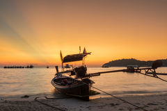 Traditional thai boats at sunset beach in Phuket Stock Image