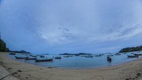 Traditional thai boats at sunset beach. Stock Image