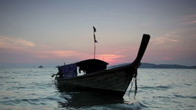 Traditional Thai boats on a sunset stock footage