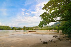 Traditional Thai boats during the tide in lagoon Stock Images
