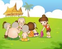 Traditional Thai boyand girl are sitting playing. Traditional Thai Children are playing traditional Thai game Stock Photos