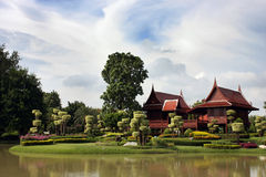 Traditional thai building. A beautiful garden with a traditional Thai house Royalty Free Stock Photo