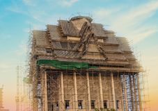 Traditional Thai church is under construction in the temple . Traditional Thai church is under construction in the temple on sunset background stock photography