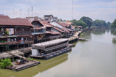 Traditional thai communities and trade boat at pier Stock Image