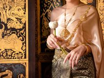 Traditional thai costume with identity, Women Thai girl holding a lotus, identity culture of Thailand.  stock photos