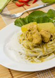 Traditional Thai cuisine. Thai rice vermicelli served with Chicken Green Curry Stock Image