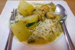 Traditional Thai cuisine, rice vermicelli eaten with green curry chicken stock photo