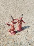 Traditional Thai dancing position dolls. And shadow on terrazzo ground floor on sunny day Royalty Free Stock Photography
