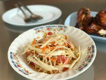 Traditional Thai famous food, spicy and tasty papaya salad. Selective focus Stock Image