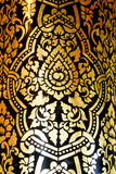 Traditional Thai fine art on a window and door pattern Temple Stock Photo