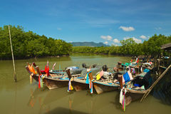 Traditional Thai fishing boats. Traditional Thai longtail fishing boats in a mangrove forest shore Royalty Free Stock Images