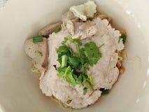Thai food, coriander on piece of pork stock image