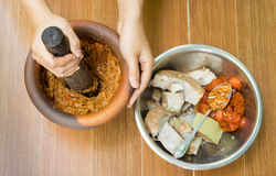Traditional Thai Food with Lady Crushing Ingredient in Rock Pot. Traditional Thai Food with Lady Crushing Ingredient in Rock Brown Pot Stock Photo