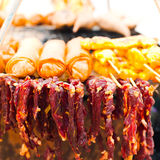 Thai food. Dry beef meat and spring rolls Royalty Free Stock Photo