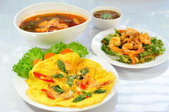 Traditional thai food set. Made with omelet with cooked seafood, Crispy deep fried morning glory salad, Shrimp And Mixed Vegetable In Tamarind Sauce and Thai royalty free stock image