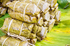 Traditional Thai food style, Glutinous rice steamed with banana Royalty Free Stock Images