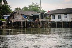 Traditional Thai houses on stilts over the water in Krabi, Thailand. KRABI, THAILAND - 14 OCT 2014: Traditional Thai houses on stilts over the water in Krabi Royalty Free Stock Photos