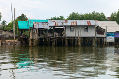 Traditional Thai houses on stilts over the water in Krabi, Thailand. KRABI, THAILAND - 14 OCT 2014: Traditional Thai houses on stilts over the water in Krabi Stock Photos