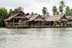Traditional Thai houses on stilts over the water in Krabi Stock Image