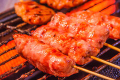 Traditional Thai Isaan Sausage roasted on the charcoal grill background. Asian, Thai styled street food appetizer.  Stock Image