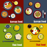 Traditional thai and korean dishes. Thai and spicy korean cuisine dishes with carrot salad, shrimps with fried rice, prawn soup and vegetable pies, grilled beef Royalty Free Stock Photography