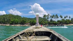 Traditional Thai Long Tail Boat. Front side of the boat view near island. HD slowmotion. Krabi, Thailand. Traditional Thai Long Tail Boat. Front side of the stock footage