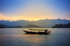 Traditional thai long tail boat at sunset, Surat Thani, Thailand Royalty Free Stock Photo