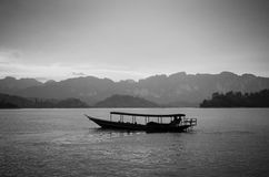 Traditional thai long tail boat at sunset, Surat Thani, Thailand Royalty Free Stock Image