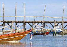 Traditional Thai long tail boats in a quiet bay Stock Photo