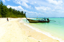 Traditional Thai Longtail boat on the island beach. Stock Image