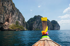 Traditional Thai Longtail boat and island of Phi Phi Leh Stock Photo