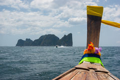 Traditional Thai Longtail boat and island of Phi Phi Leh on the Royalty Free Stock Images