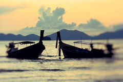 Traditional thai longtail boat at sunset Nui Bay Beach. Thailand Royalty Free Stock Photography