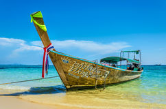 Traditional thai longtail boat in Thailand. Traditional thai longtail boat at famous sunny Long Beach, Thailand, Koh Phi Phi Don, Krabi province, Andaman sea Stock Photo