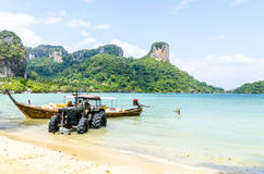 Traditional Thai Longtail boatAnd tractor. Stock Images
