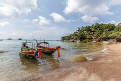 Traditional Thai longtail boats at the beach