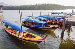 Traditional Thai Longtail boats at pier Stock Photos