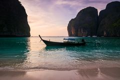 Traditional thai longtale boat at Maya bay in Phi Phi Island. Lo. Cation: Krabi Province, Thailand, Andaman Sea. Artistic picture. Beauty world Royalty Free Stock Photo