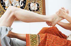 Traditional thai massage health care foot kneading Stock Photos