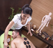 Traditional thai massage - man getting hotstone treatment Royalty Free Stock Photo